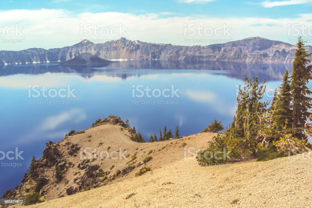 Crater Lake in Oregon with a trail zbiór zdjęć royalty-free