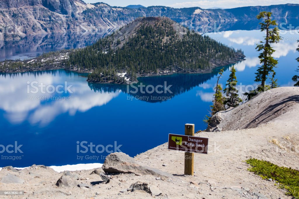 Crater lake sign to protect tourists from falls stock photo