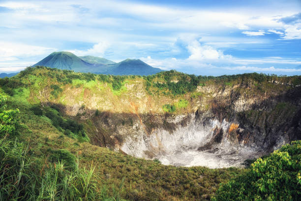 Crater of Volcano Mahawu near Tomohon. North Sulawesi. Indonesia Tomohon, North Sulawesi, Indonesia - October 03, Beautiful colours as the sun sets over Manado, Sulawesi in Indonesia sulawesi stock pictures, royalty-free photos & images
