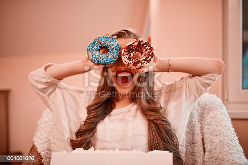 692840848istockphoto craving for delicious donuts 1004001626