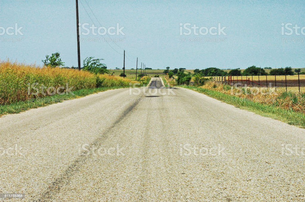 Crawford Texas Country Road with fencing stock photo