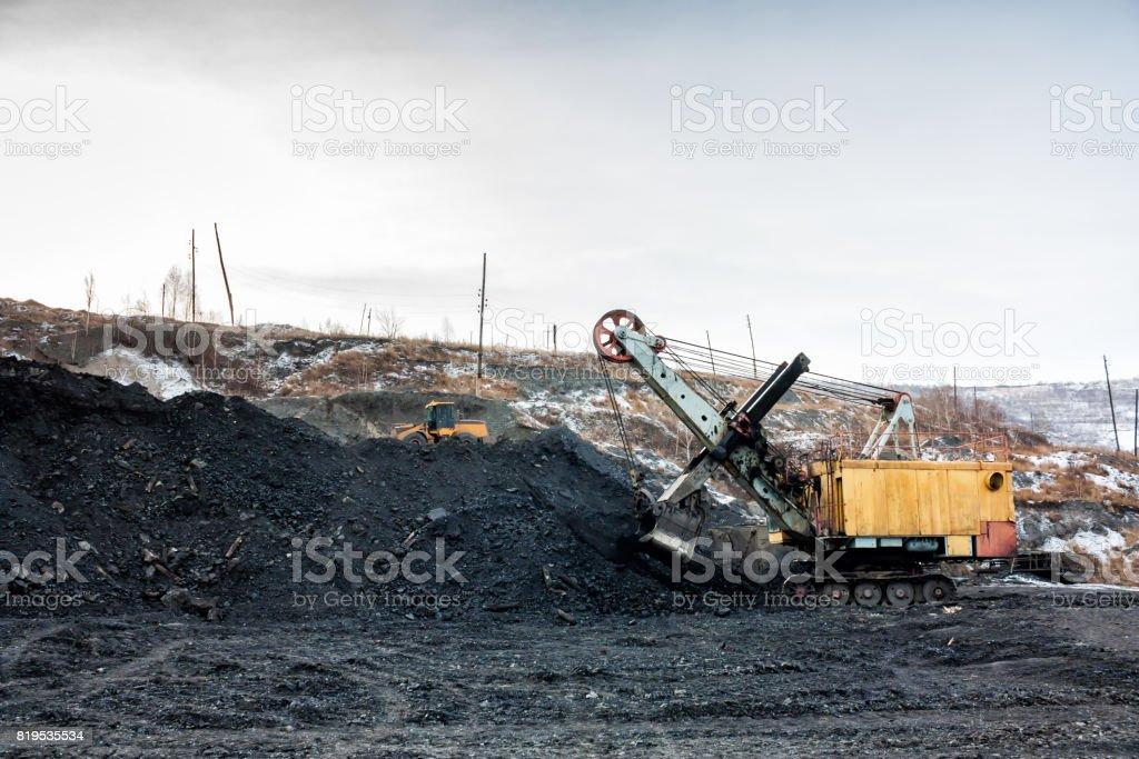 Crawler excavator in a coal quarry stock photo