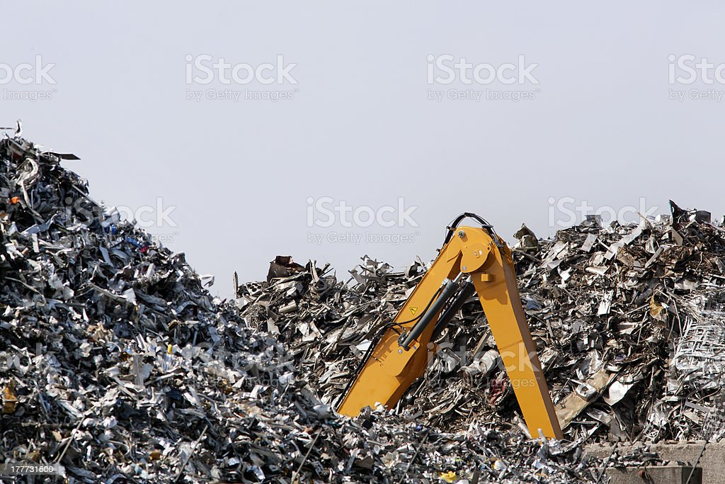 Crawler excavator lost in metal scrap royalty-free stock photo