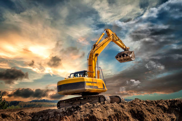 Crawler excavator Crawler excavator during earthmoving works on construction site at sunset archaeology stock pictures, royalty-free photos & images