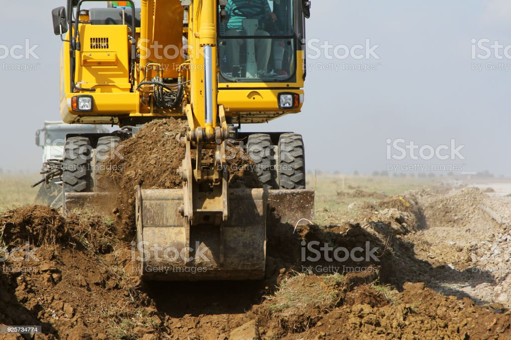 Crawler excavator working on a highway construction site stock photo