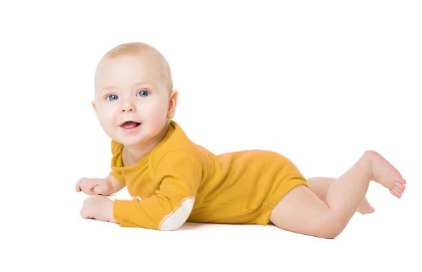 Crawling Baby Boy, Happy Infant Kid Lying on White, Six Months Old Child stock photo