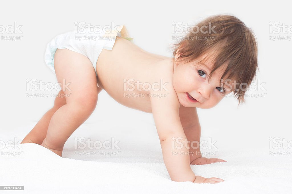 Crawling baby girl stock photo