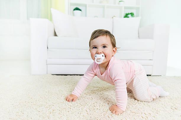 Crawling baby stock photo