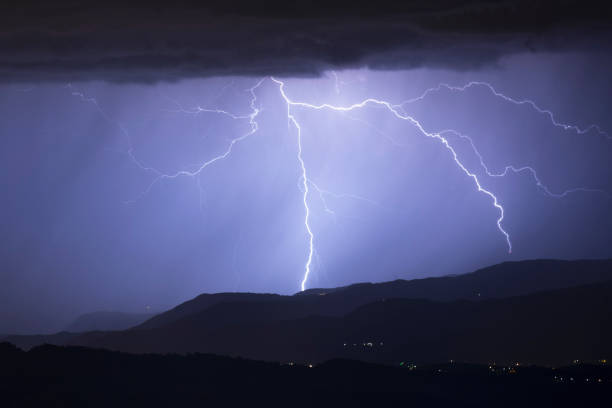 crawling lightning over italy stock photo