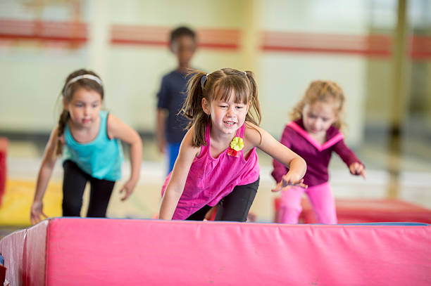 Crawling Over Gymnastics Mats stock photo