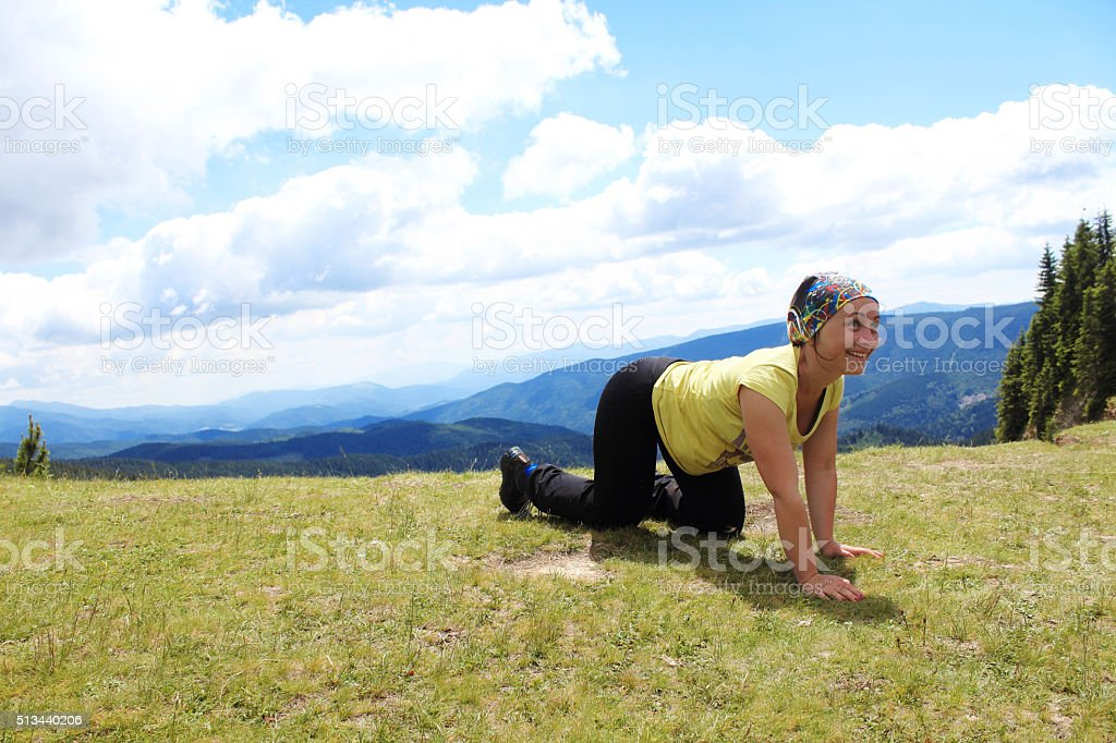 Crawling woman in mountains stock photo