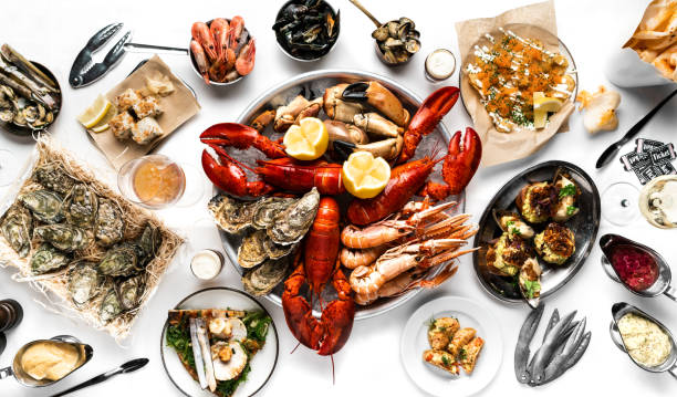 Crayfish and seafood table top view. Lobsters, crayfish, shrimps, clams, oysters, sushi Crayfish and seafood table top view. Lobsters, crayfish, shrimps, clams, oysters, sushi. On a white tablecloth seafood stock pictures, royalty-free photos & images