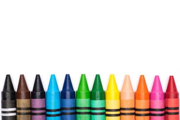 Crayon rainbow Row of crayons in colours of rainbow on white background crayon stock pictures, royalty-free photos & images