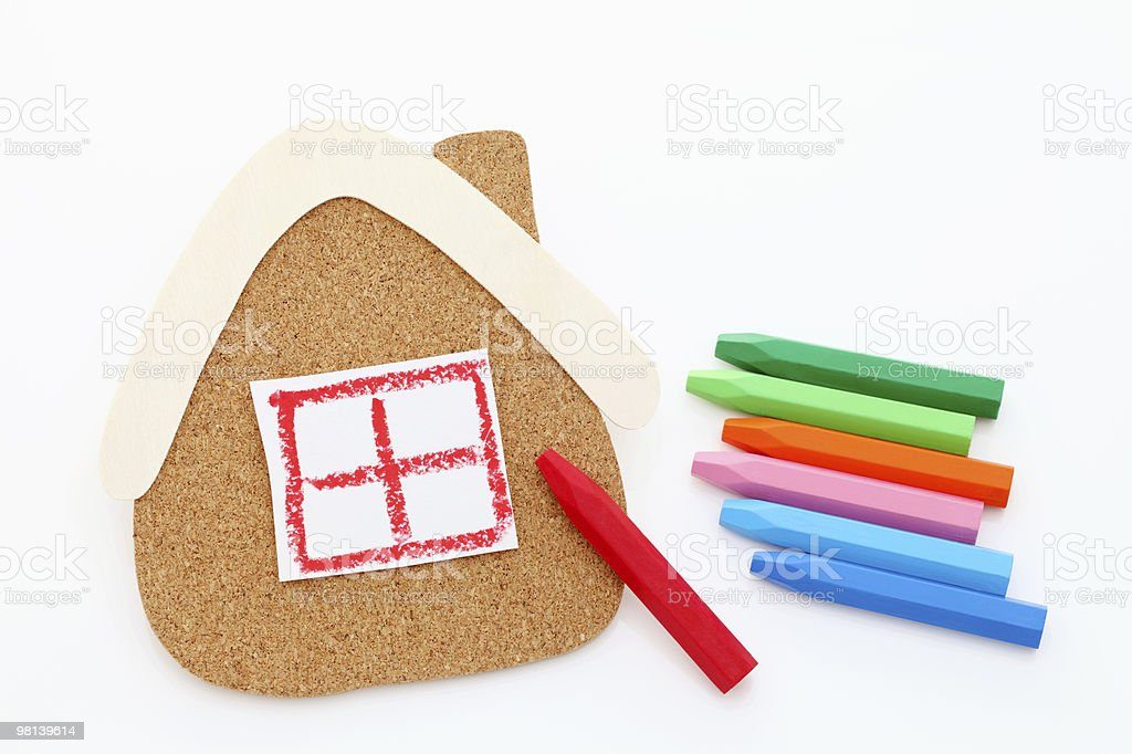 Crayons and Cork board of house type royalty-free stock photo