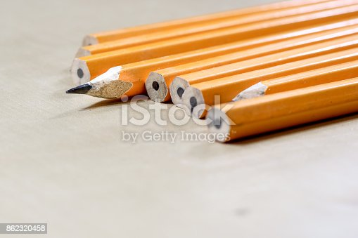 951081060 istock photo crayons and pencil sharpener on a wooden office table. Crayons with sharpening crayons and pencils on the table next to colored pencils. black background. 862320458