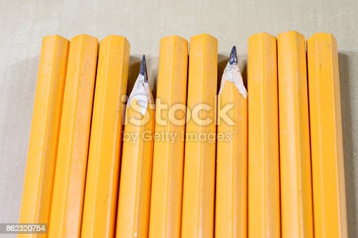 951081060 istock photo crayons and pencil sharpener on a wooden office table. Crayons with sharpening crayons and pencils on the table next to colored pencils. black background. 862320754