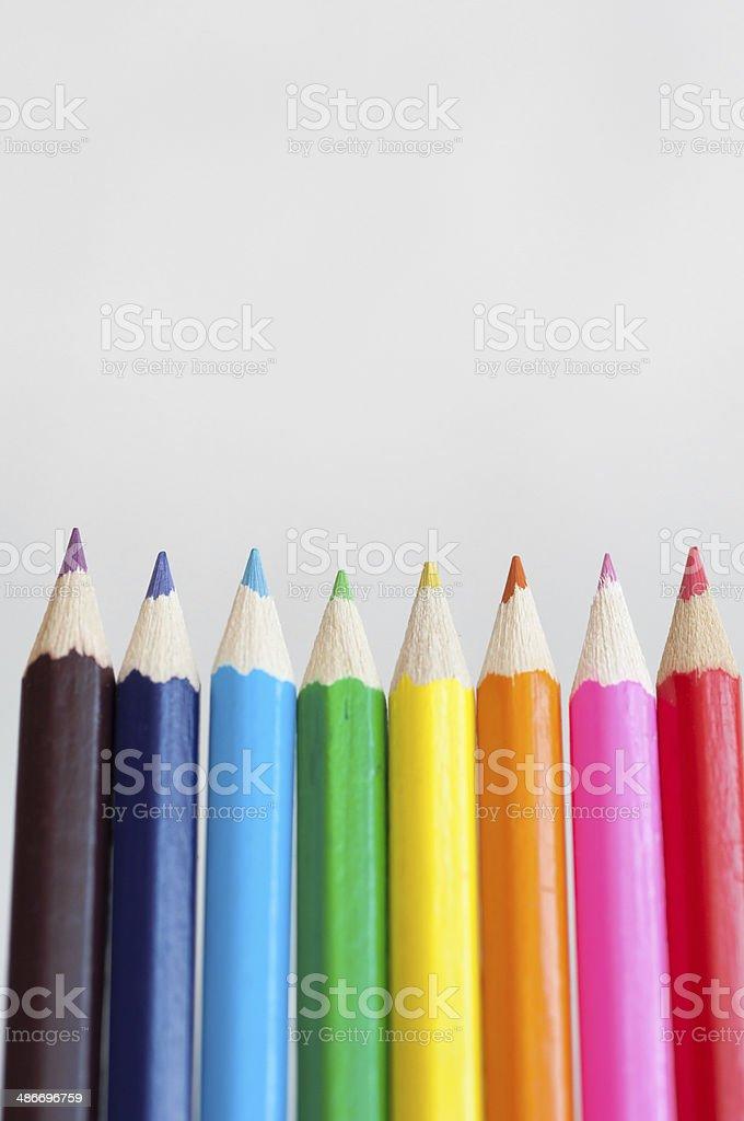 Crayons edgewise on white background. stock photo