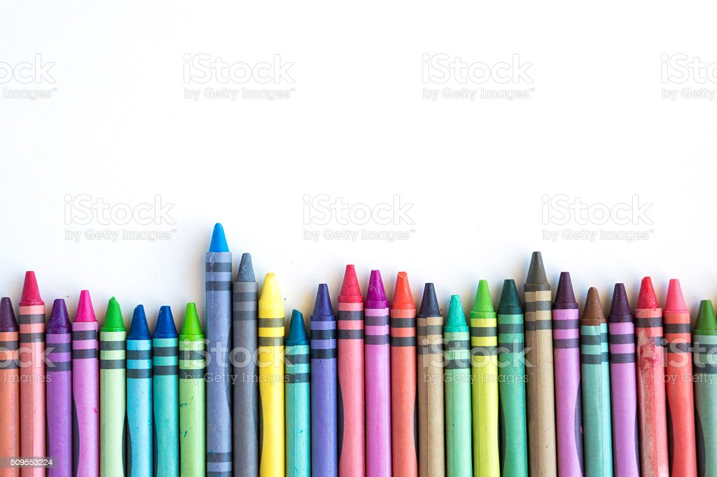 Crayons lined up isolated on white background