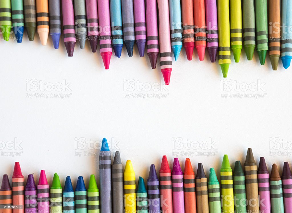 Crayons lined up isolated on white background stock photo