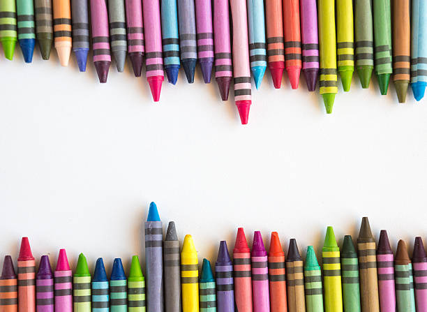 Crayons lined up isolated on white background Crayons and pastels lined up isolated on white background for banner crayon stock pictures, royalty-free photos & images