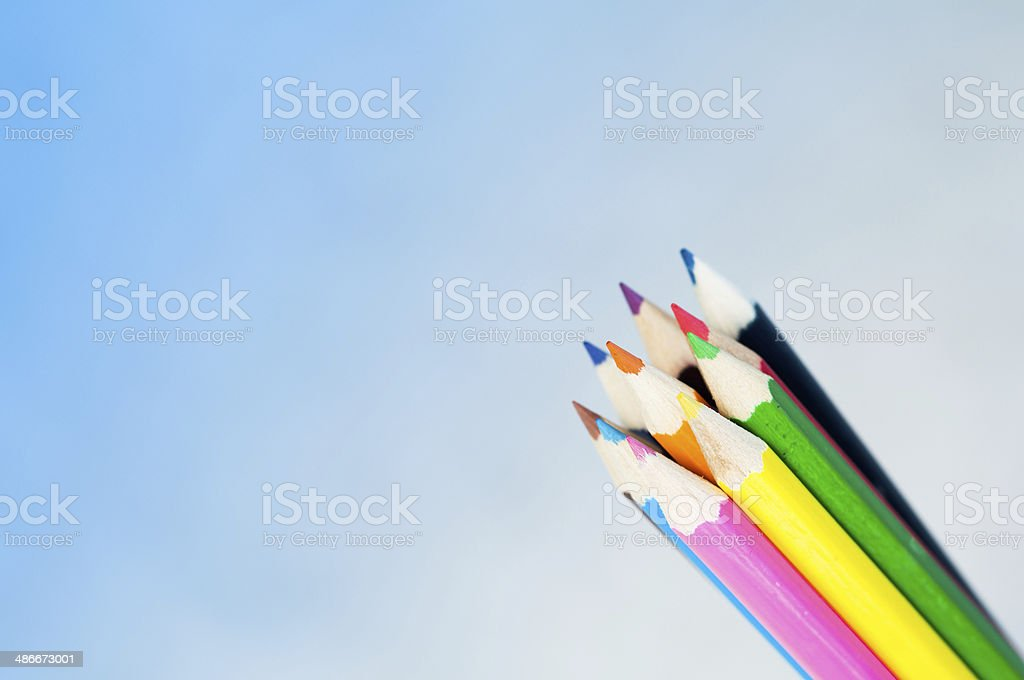 Crayons on sky background. stock photo