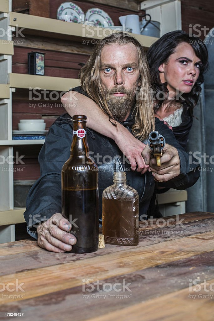 Crazed Western Man With Woman at Table stock photo