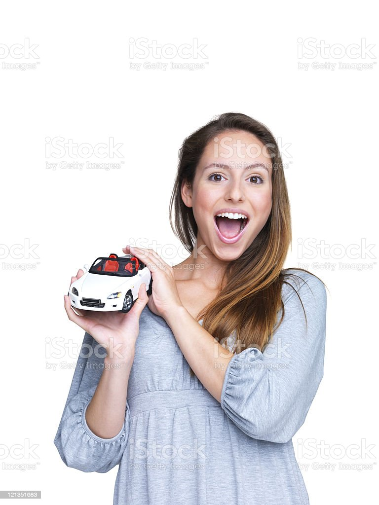 Crazy about cars - Excited young female holding toy car royalty-free stock photo