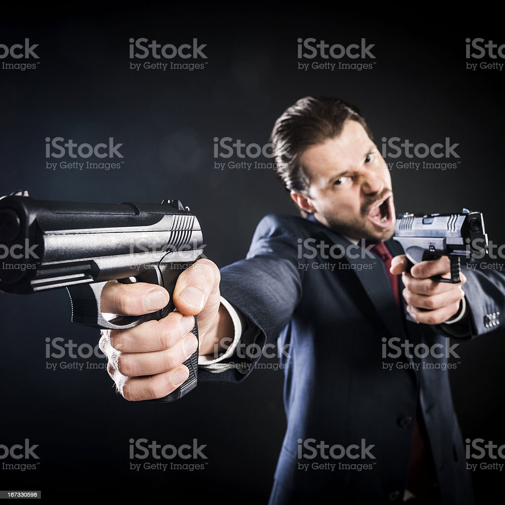 Crazy assassin, suit aiming with two guns, killer, mafioso, gangster royalty-free stock photo