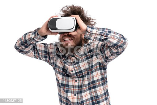 istock Crazy bearded man with VR goggles 1130537125