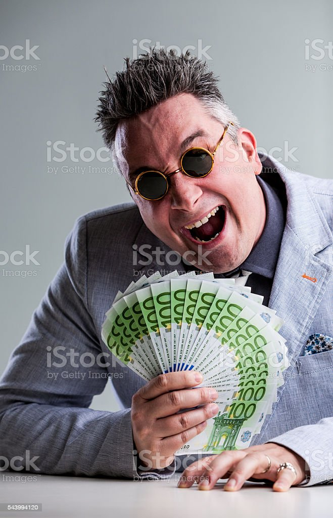 crazy buisnessman with money and sunglasses stock photo