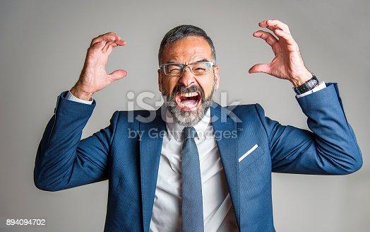 661896674istockphoto Crazy business man yelling 894094702