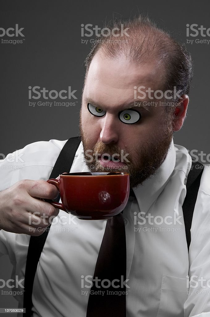 Crazy Businessman and His Coffee stock photo