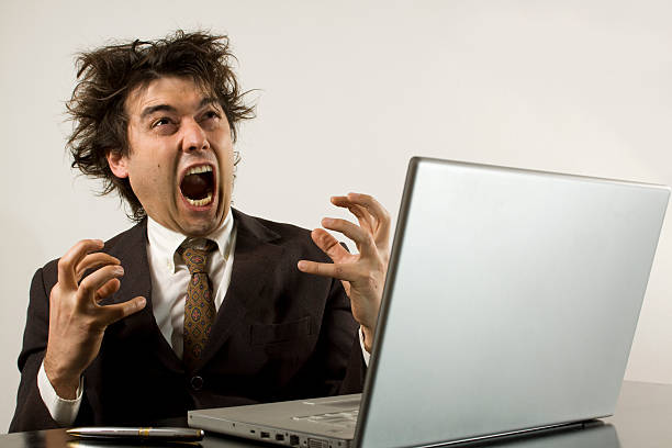 crazy businessman frustrated with his computer - frustrated man stock photos and pictures