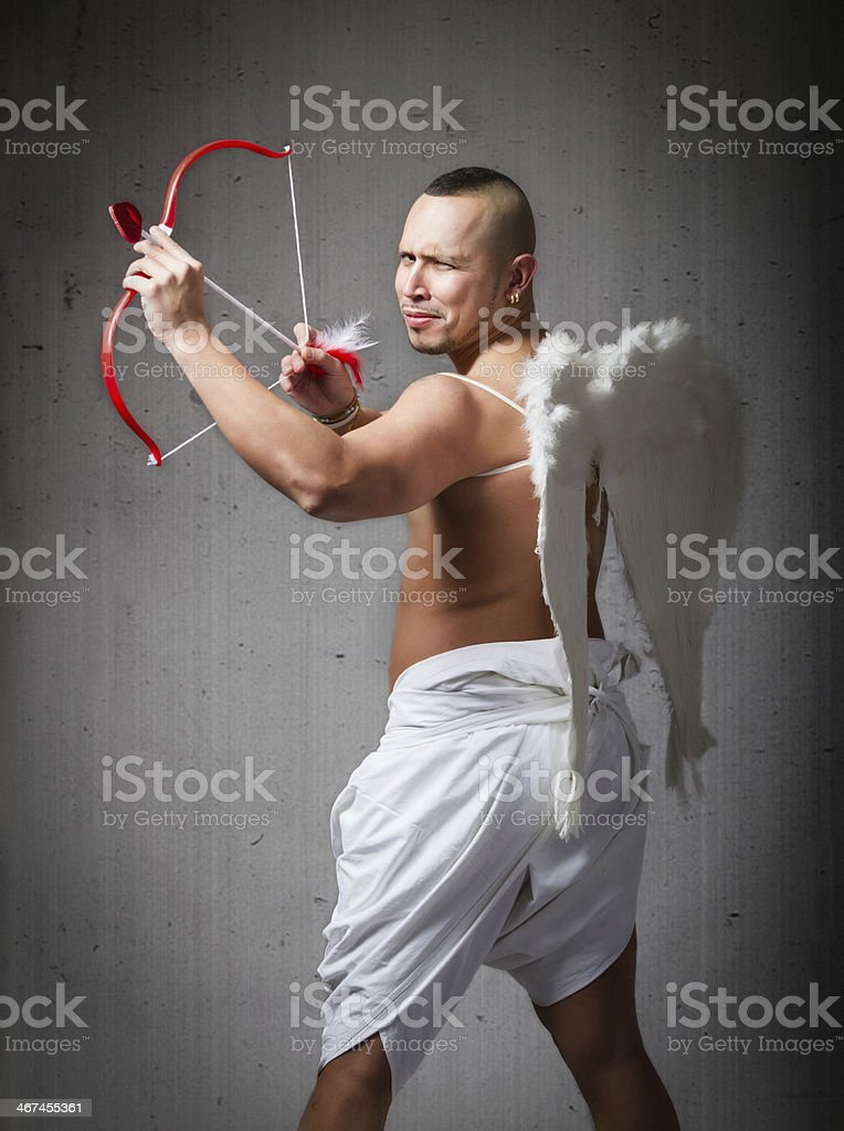 Crazy Cupid aiming with bow stock photo