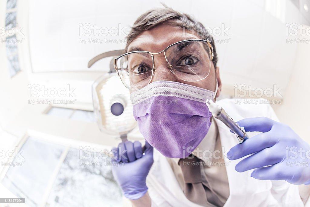 Crazy Dentist with Syringe stock photo