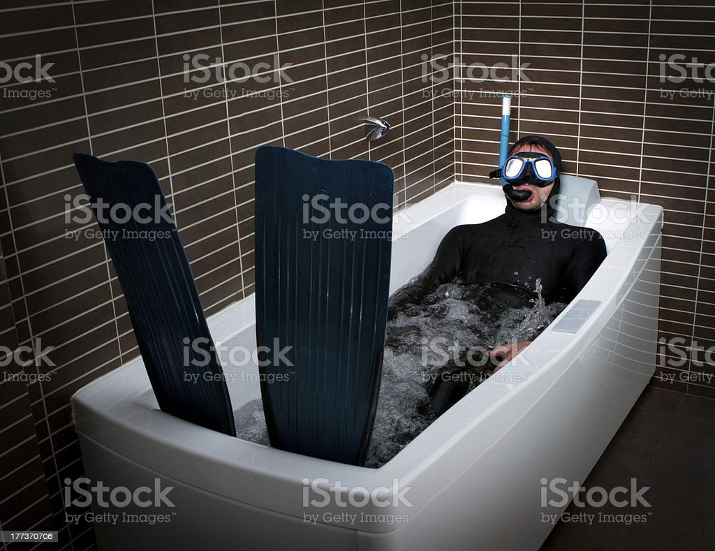 crazy diver with flipper and mask in a bathroom stock photo