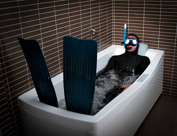 crazy diver with flipper and mask in a bathroom