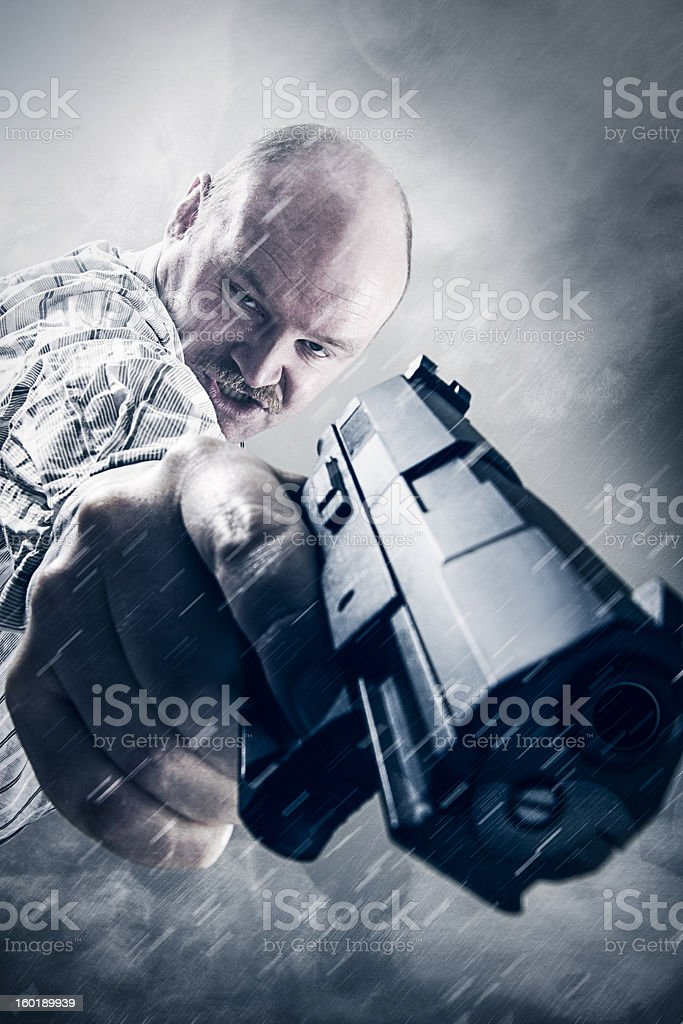Crazy Dude with Gun in Snow and Smoke stock photo