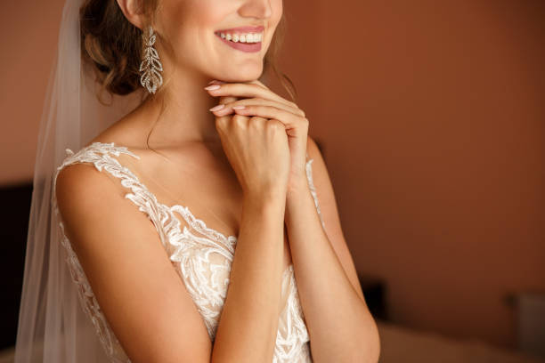 Crazy emotions of the bride during the first meeting with the groom at wedding day. stock photo