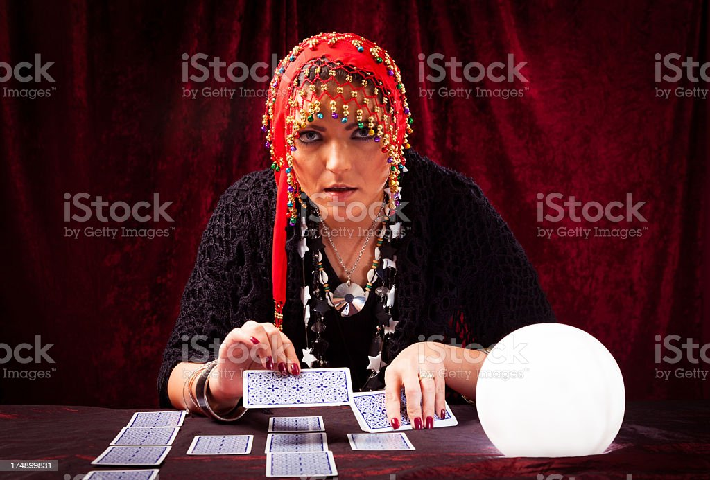 crazy fortune teller with tarot cards royalty-free stock photo