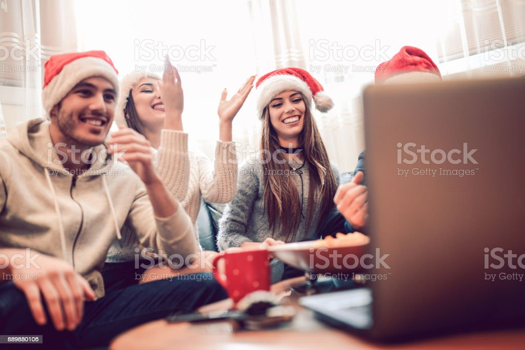d7db8367988c1 Crazy Friends wit Santa Hats Having Fun at The Christmas Party - Stock  image .