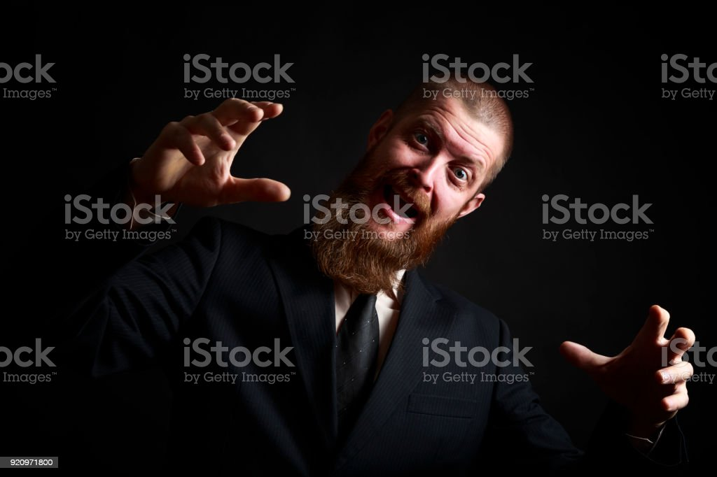 Crazy Funny face. Handsome businessman with beard and handlebar mustache looking at camera stock photo