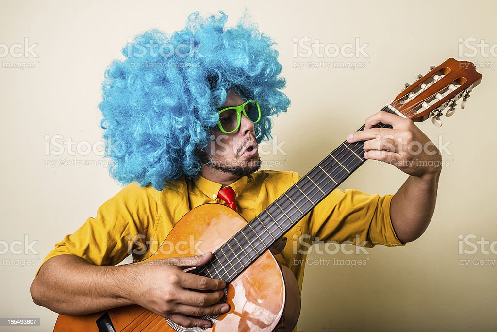 crazy funny young man with blue wig royalty-free stock photo