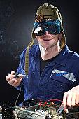 istock Crazy genious witth soldering iron 120515147