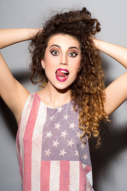 Crazy girl in american flag printed shirt stock photo