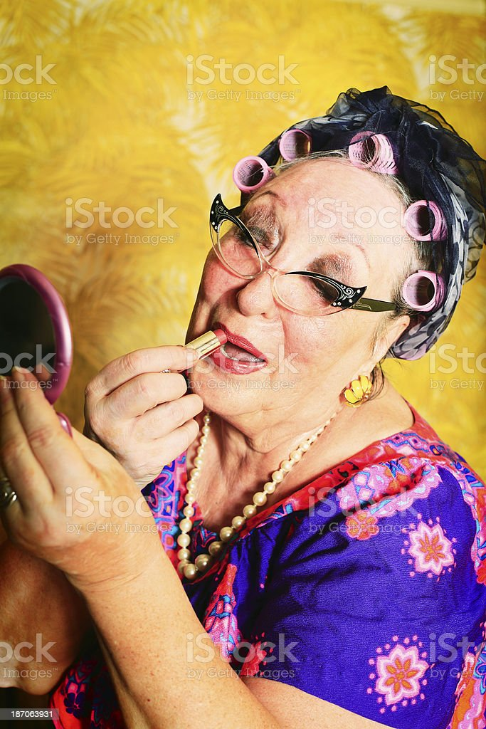 Crazy Granny Putting On Her Makeup stock photo