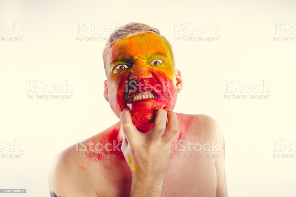 A bizarre portrait of a man with a painted body. Concept: sports fan