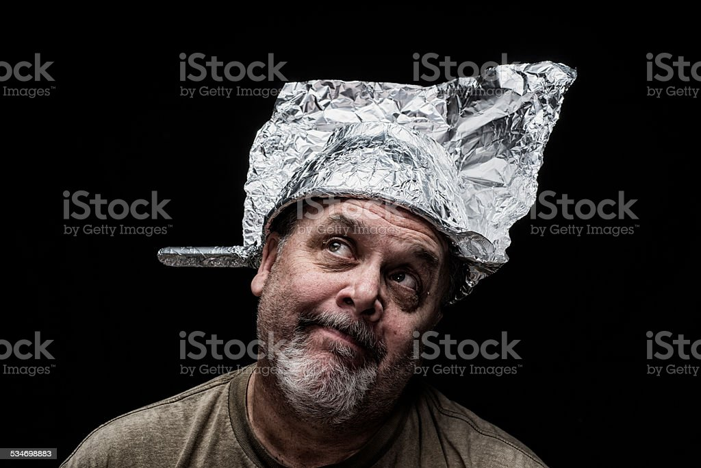 Crazy Guy wearing a colander as a hat stock photo