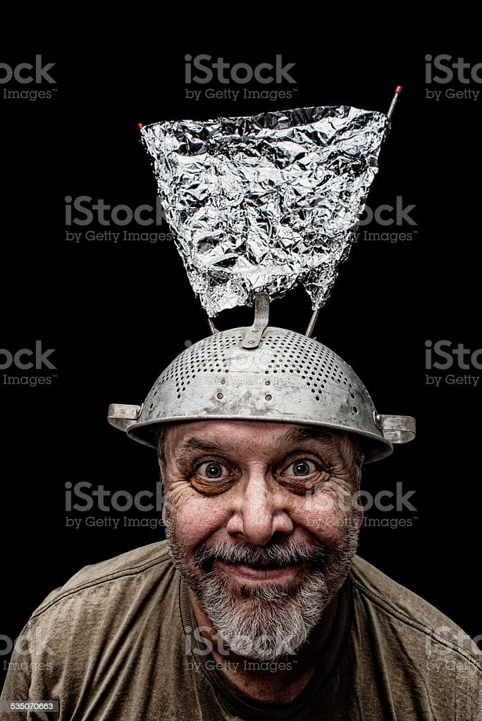 Crazy Guy wearing a colander with antenni as a hat stock photo