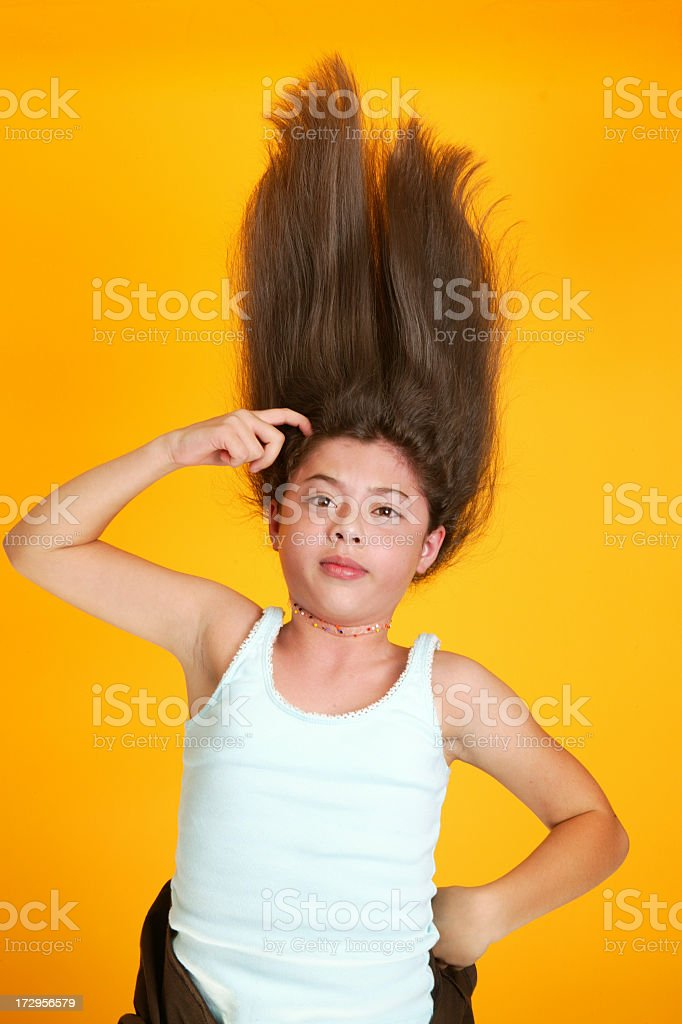 Girl with crazy hair shot in studio on yellow background. Shot on...